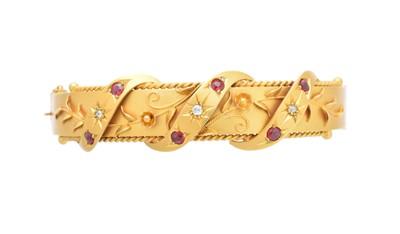 Lot 2 - A 9ct gold hinged bangle