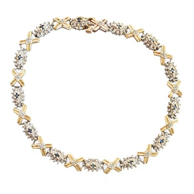 Lot 4-A 9ct gold diamond and sapphire bracelet