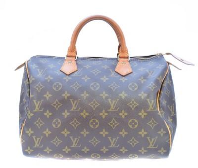 Lot 35-A Louis Vuitton monogram Speedy 30 handbag