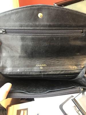 Lot 103 - A Chanel Flap Logo Bifold Long Wallet