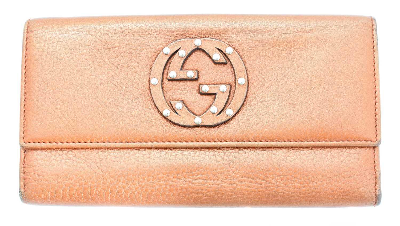 Lot 27-A Gucci logo trifold long wallet