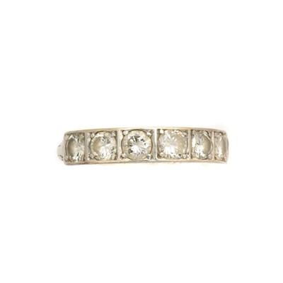 Lot 215 - A diamond band ring