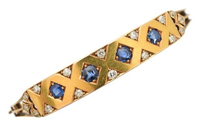 Lot -A Victorian sapphire and diamond hinged bangle
