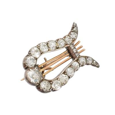 Lot 25-A Victorian diamond lyre brooch