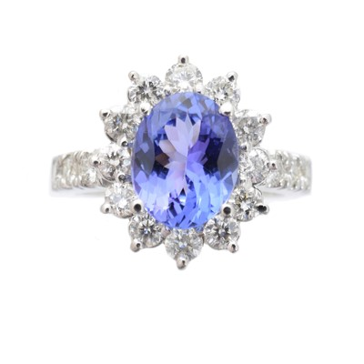 Lot -A tanzanite and diamond cluster ring