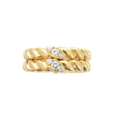 Lot -An 18ct gold diamond band ring by Van Cleef & Arpels