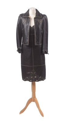 Lot 12 - A leather set by Escada