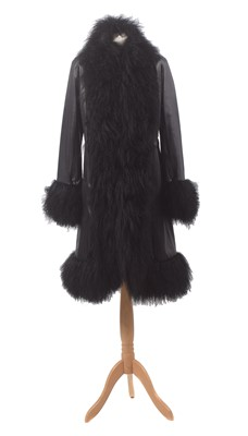 Lot 4-A leather and wool coat by Harrods of Knightsbridge