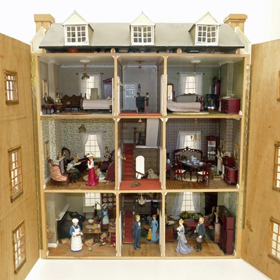 Lot 29-Dolls house in the form of a Georgian four-storey townhouse with furniture and figures.