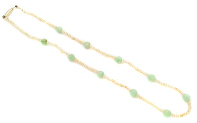 Lot 30 - A seed pearl and jade necklace