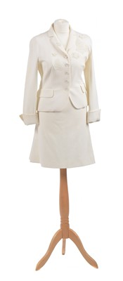 Lot 59 - A white suit by Moschino