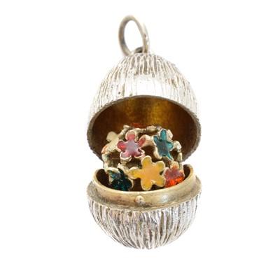 Lot 86 - A silver and enamel egg pendant by Stuart Devlin
