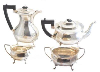 Lot -A George V silver four piece teaset