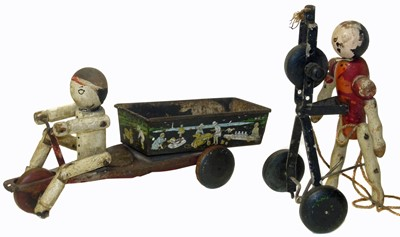 Lot 40-Hustler Toy Corporation tin plate toy wooden figure peddling a tricycle etc.
