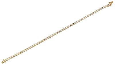 Lot 12 - A 9ct gold diamond brilliant cut diamond line bracelet