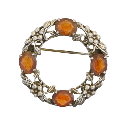 Lot 11 - An Arts & Crafts style citrine brooch