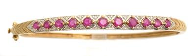 Lot 9 - A ruby and diamond hinged bangle