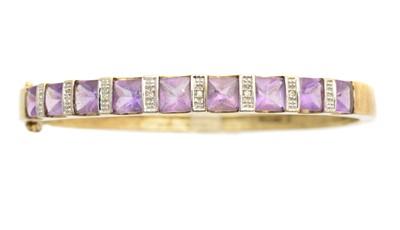 Lot 13-A 9ct gold amethyst and diamond hinged bangle