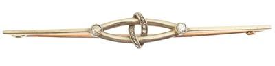 Lot 27-An early 20th century diamond bar brooch