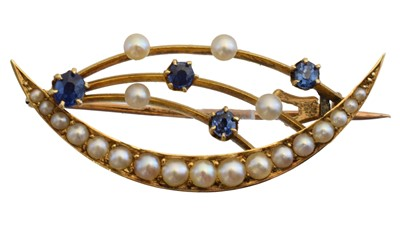 Lot 32-An early 20th century crescent brooch