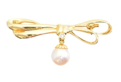 Lot 15-A cultured pearl and diamond brooch