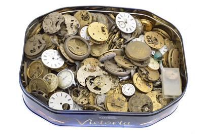 Lot 61 - A box of pocket watch and wristwatch movements and parts