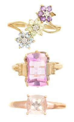 Lot 150 - Three gem set dress rings