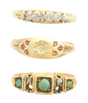 Lot 124 - Three gem set dress rings