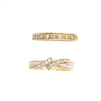 Lot 137 - Two 9ct gold diamond band rings