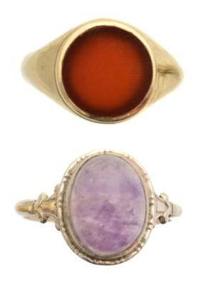 Lot 49 - Two gem set dress rings