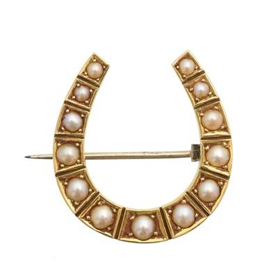 Lot 20-A split pearl horseshoe brooch