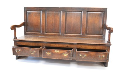 Lot 393 - George III oak box settle