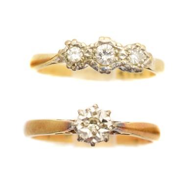 Lot 130A - Two diamond dress rings