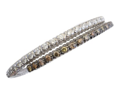 Lot 14 - An 18ct gold diamond hinged bangle