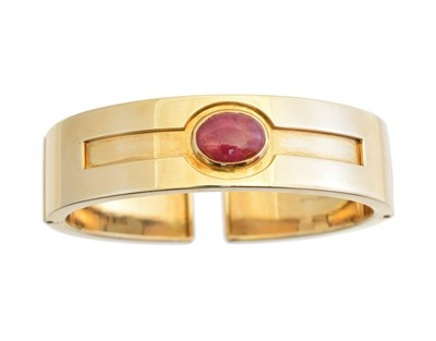 Lot 12 - A ruby hinged bangle by Bulgari