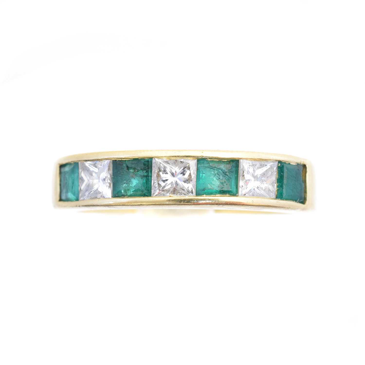 Lot An 18ct gold emerald and diamond band ring