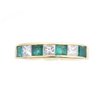 Lot 93 - An 18ct gold emerald and diamond band ring