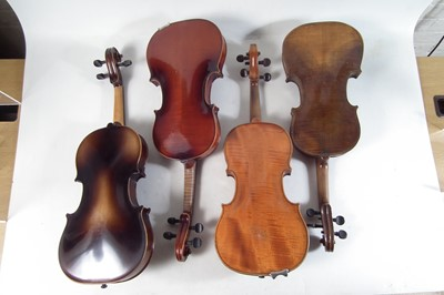 Lot 20 - Four violins in cases
