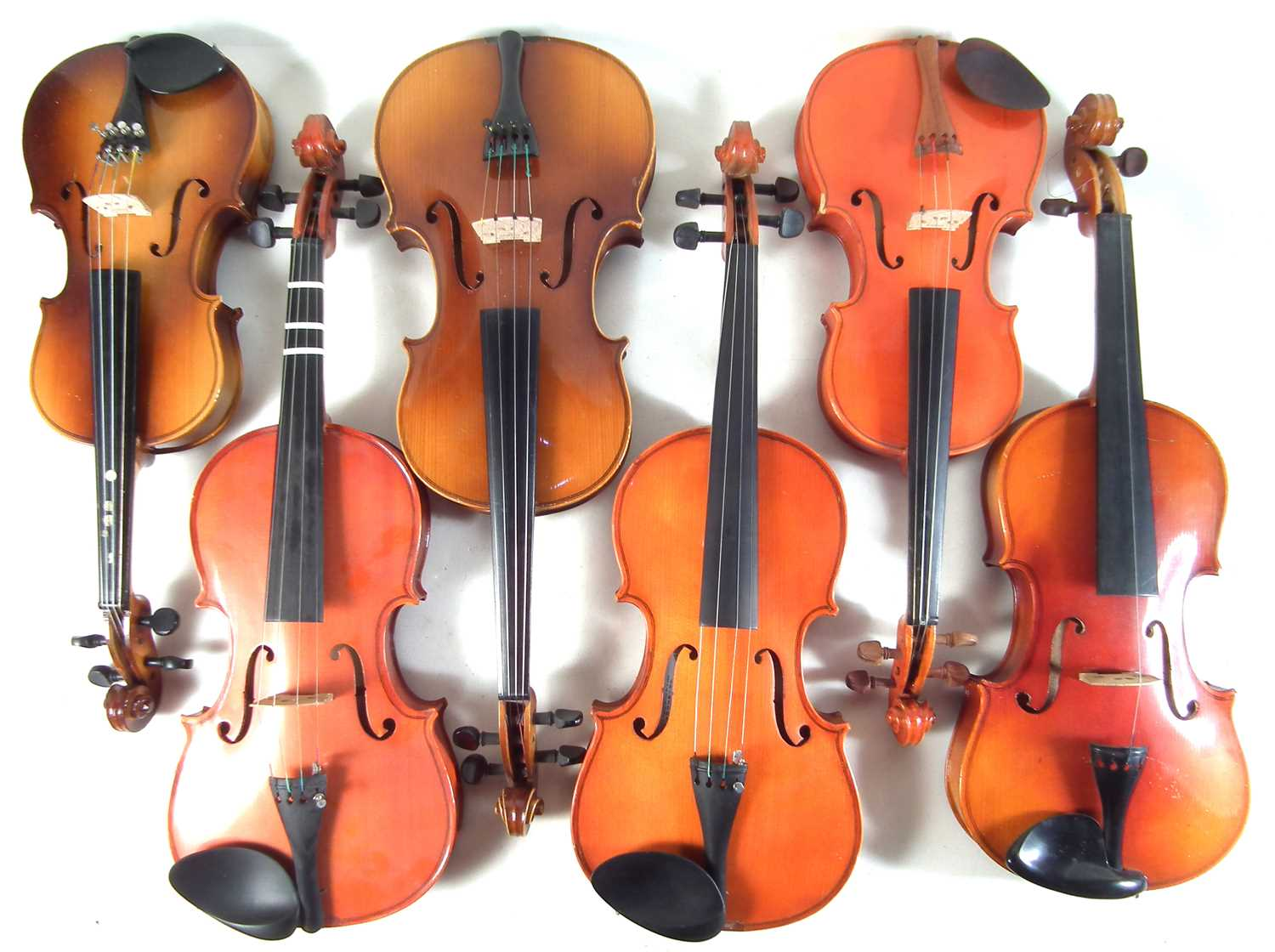 Lot 21 - Six Chinese violins in cases