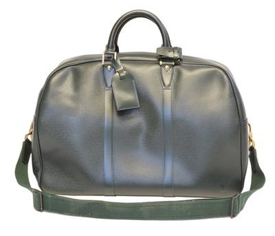 Lot 87 - A Louis Vuitton Taiga Kendall PM luggage bag