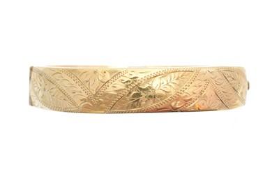 Lot 4 - A 9ct gold hinged bangle