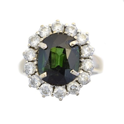 Lot 98 - A tourmaline and diamond cluster ring