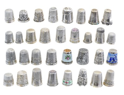 Lot 114 - A large selection of silver and white metal thimbles