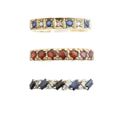 Lot 48 - Three 9ct gold gem-set band rings