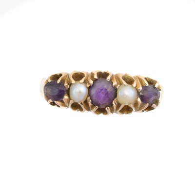 Lot 46 - An amethyst and split pearl five stone ring