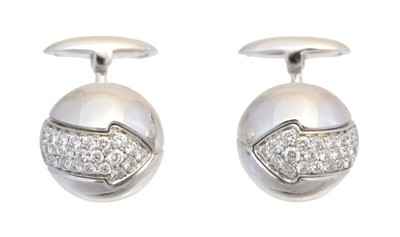 Lot 127 - A pair of diamond cufflinks by Enigma