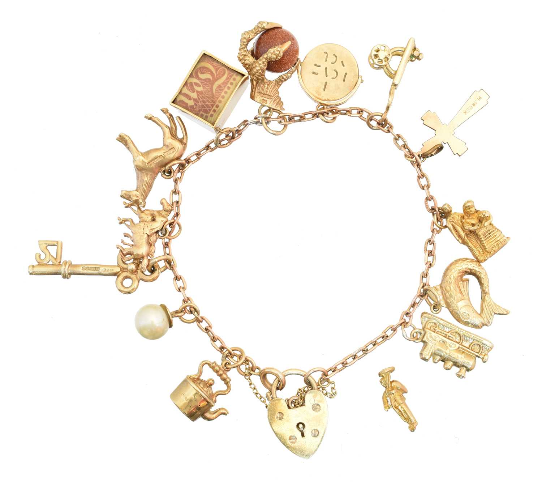 Lot 30 - A 9ct gold charm bracelet