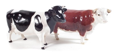Lot 126 - Beswick Hereford cow and a Friesian cow.