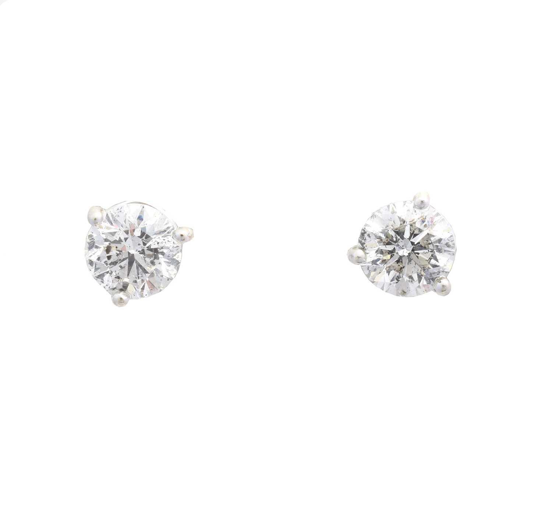 Lot A pair of brilliant cut diamond stud earrings