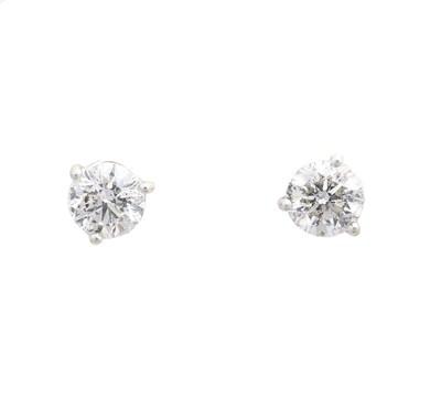 Lot 35 - A pair of brilliant cut diamond stud earrings